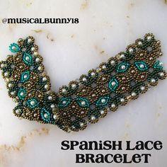 Unfinished Spanish Lace Bracelet (pattern by Jaycee Patterns @ Etsy) in a Celtic color palette