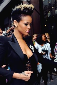 Rhianna jet black into blonde tips...