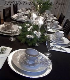 In keeping with the feel of the dining room I dressed the table in shades of silver and white adorned with touches of fresh green pine...