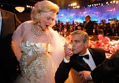 Actor George Clooney kisses the hand of philanthropist Barbara Davis during the 26th Carousel of Hope Ball in Beverly Hills, California. (Reuters)