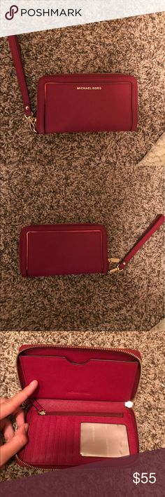 Michael Kors wallet/ wristlet Perfect condition- nice red/ maroon color Michael Kors Bags Clutches & Wristlets
