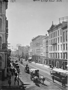 Looking South down Water Street from Wisconsin Ave 1885. The Iron Block is on the left.
