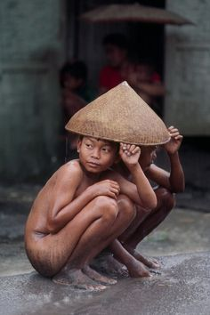 Kids under a caping, Indonesia from Right as Rain series by Steve McCurry