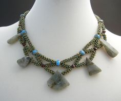Cubic right angle weave beaded necklace, but I'd use different pendant beads.