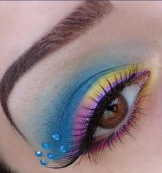 Stunning yellow, pink and blue eye shadow accented by six aqua crystals. Blue Eyeshadow, Eyeshadow Looks, Crystal Tattoo, Photoshoot Makeup, Models Makeup, Makeup Designs, Face Art, Beautiful Eyes, Makeup Inspiration