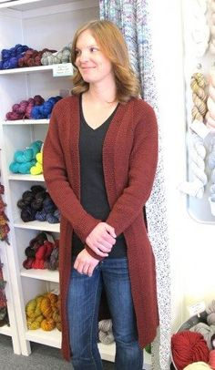 Knitting Pure & Simple 1405 A long cardigan with seed stitch edges, worked…