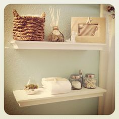 Beach bathroom...love the neutral colors and the shells