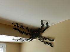 Giant spiders made with black balloons and black streamers, similar to the game