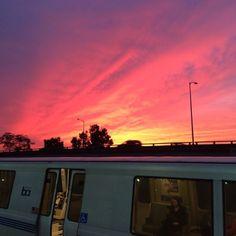 December 2013: Sunset over Oakland, Mac Arthur BART station. photo © Domini Dragoone.