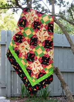 Hot Peppers Quilt by EQuiltShop on Etsy Quilt Sizes, Patio Table, Stuffed Hot Peppers, Mild Soap, Make And Sell, Pin Cushions, Black Backgrounds, Quilt Blocks, Cotton Fabric