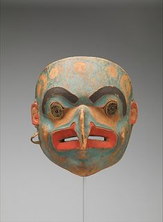 Transformation Mask | Date: 1820–30 | Geography: United States, Alaska | Culture: Tlingit |  Medium: Wood, paint, metal coins, native-tanned skin