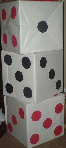 Large dice...cardboard boxes and white wrapping paper, construction paper dots
