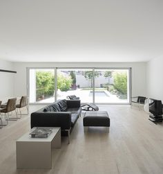 Elegant All-White Home Surrounded by Green Space in Parede, Portugal