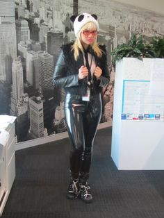 Girl wears black latex pants with black sneakers and faux fur and veggie leather jacket. A furry hat completes the outfit.. DIY the look yourself: http://mjtrends.com/pins.php?name=black-latex-for-clothing