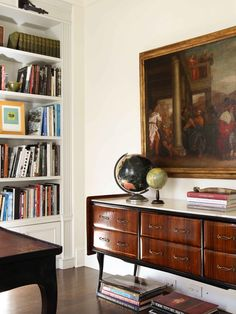 """""""lovely book shelf in the wall, beautiful old world paining lending classic elegance to the study"""""""