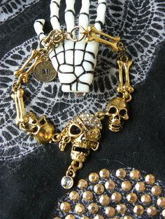 Bracelet *Pirates*, Skull, Or et Bronze. : Bracelet par dys