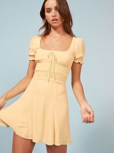 Well aren't you precious. This is a mini length dress with a smocked waist and a square neckline. #vintagerings