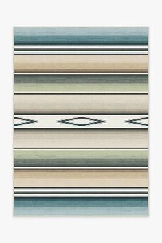 Take your contemporary home decor south of the border with this Falsa Stripes Sage Rug. Inspired by traditional Mexican serape blankets, the striped weave motif is tinted in mellow tones of sage and teal blue with a chic ombre effect. Teal Rug, Turquoise Rug, Stone Rug, Machine Washable Rugs, South Of The Border, Contemporary Home Decor, Black Rug, Colorful Rugs, Sage