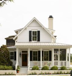 white house, black shutters, wooden door