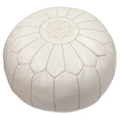 Handmade Moroccan leather pouf with silk thread embroidery.   Product: PoufConstruction Material: Leather shell...