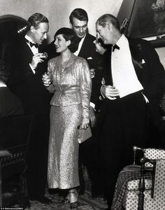 LESLIE HOWARD, NORMA SHEARER, GARY COOPER & LIONEL BARRYMORE at a Christmas Eve party given by Cooper at his home in Hollywood in 1932