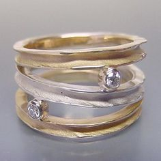 18k yellow gold, sterling silver, diamonds by Ann Marie Cianciolo