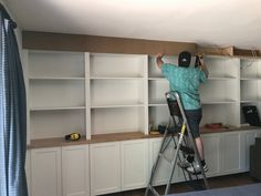 All about how we DIY'd our built in bookshelves using IKEA cabinets. Built In Shelves Living Room, Living Room Storage, Wall Storage, Living Rooms, Home Office Cabinets, Ikea Cabinets, Built In Cabinets, Custom Bookshelves, Bookshelves Built In