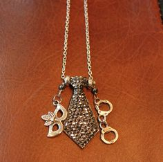 Fifty Shades of Grey Trilogy Inspired Necklace. $43.00 USD, via Etsy.