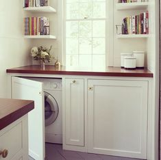 Put the laundry inside under the window in the kitchen.