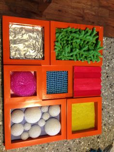 Handmade sensory touch and feel board. For splats  squiggles creative studios my five senses class!