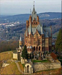 With its dreamy spires, mock battlements and square clock tower, Schloss Drachenburg, which stands on a wooded hill high above the river Rhine, looks like a cross between a medieval castle, a Gothic cathedral and Big Ben.  Topic  Germany    According to Norse myth, Siegfried slayed a dragon just a little farther up the mountain. This spectacular building, a jumble of architectural styles, was erected in less than three years in the late 19th century by a wealthy stockbroker.