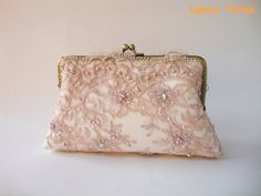 Elegant wedding clutch, Lace Silk Clutch in Dusty Pink, Vintage inspired , wedding bag, bridesmaid clutch, Bridal clutch. $70.00, via Etsy.