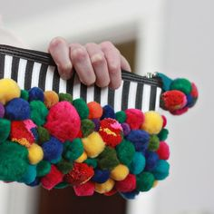 "Get funky with pom-poms, the new ""It"" accessory trend."