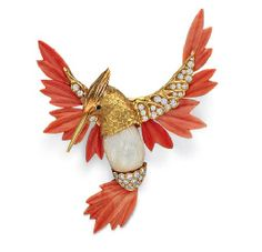 A CORAL, MOTHER-OF-PEARL AND DIAMOND HUMMINGBIRD BROOCH, BY KUTCHINKSY