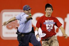 On the field: WATCH OUT: A law enforcement officer chased down a fan who ran onto the field before the eighth inning of a baseball game between the Philadelphia Phillies and the St. Louis Cardinals in Philadelphia on Monday. Police Commissioner Charles Ramsey reviewed video of the arrest and felt the officer acted within department guidelines, which allows officers to use tasers to arrest fleeing suspects, said a spokesman. (Matt Slocum/Associated Press)