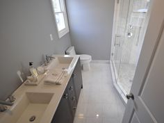 Master Bathroom with Double Vanity and Stand Up Shower.