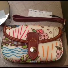 Dooney and Burke Aulani Wristlet Selling a new with tags Dooney and Burke Wristlet. This is a Wristlet from the Disney resort in Hawaii. It is now retired. NWT This Is Firm Price. Dooney & Bourke Bags Clutches & Wristlets