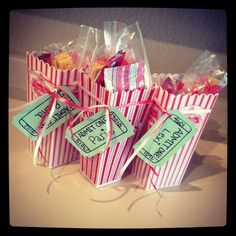 Movie night! Gift baskets filled with snacks for the girls. Admit one tickets with each girls name on it.On the back date, time and name of the movie.