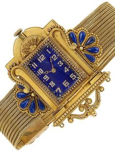 Archaeological Revival Gold and Lapis Mesh Slide Bracelet-Watch  Mechanical, centering a rectangular blue enamel dial with applied gold Arabic numerals, set within a case of architectural form, accented with gold balls, flanked by a fan of 10 pear-shaped cabochon lapis edged by small gold balls, completed by a herringbone link mesh bracelet accented by lapis slides of similar design, circa 1870, movement signed Koehn