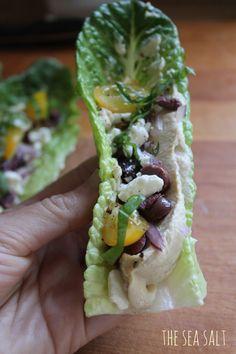 Garlic hummus, avocado lettuce wraps with tomato, sea salt and pepper ...