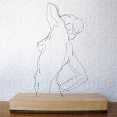 Beautiful wire sculpture and paper cut portraits by Gavin Worth.