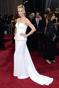 2013 was a quiet year for Theron as she didn't appear in any movies but was still hard at work! Here, a short haired Theron dons a lovely white Dior gown to the Oscars on Feb. 24, 2013.