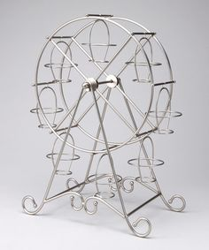 Everyone has seen the standard cupcake tree, cupcake stand etc. but this one is unique, a ferris wheel cupcake stand, somehow I don't htink it comes off as cheesy. Circus Birthday, Circus Theme, Circus Party, Ferris Wheel Cupcake Holder, Cupcake Display, Cupcake Stands, Carnival Themes, Carnival Food, Chandeliers