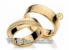 Par de alianças de noivado e casamento  Alianças em ouro amarelo 18k 750  Peso: 14 gramas o par  Pedras: 18 diamante de 1 ponto   http://www.wmjoias.com.br/