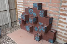 Cinder block planter wall. I wouldn't want the brown and blue but that would be cool in bright colors and filled with plants.