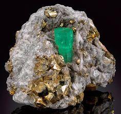 bijoux-et-mineraux:  Emerald and Pyrite on Calcite - Coscuez Mine, Mun. de Muzo, Vasquez-Yacopí Mining District, Boyacá Department, Colombia