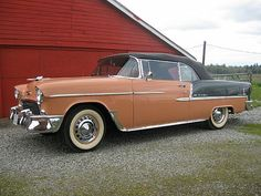1955 Chevrolet Bel Air / IT WAS DARK AND THE LOT HAD PINK NIGHT LIGHTS. THE SALESMAN SAID IT WAS ROSE CORAL & BLACK..