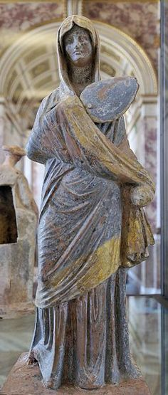 File:Lady in blue Louvre ,from Tanagra  Greek  terracotta,3th cent.BC