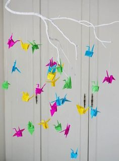 Baby mobile made from colorful origami paper cranes