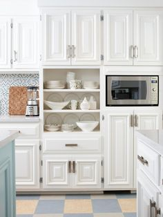 Designer Sarah Richardson is always one to think outside the box. Here, rather than leave the doors on all the cabinets, she removed just one set so her vintage white dishware is within easy reach.